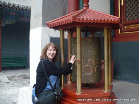 Celia and some prayer wheels at the Lama Temple